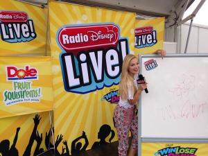 Look at @olivia_holt's drawing of a flower at #RDLive Fueled By @DoleFoods Fruit Squish'ems @ KidSpree in Denver, CO!